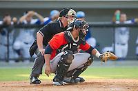 Greeneville Astros catcher Jacob Nottingham (27) sets a target as home plate umpire Matt Davis looks on during the game against the Burlington Royals at Burlington Athletic Park on June 29, 2014 in Burlington, North Carolina.  The Royals defeated the Astros 11-0. (Brian Westerholt/Four Seam Images)