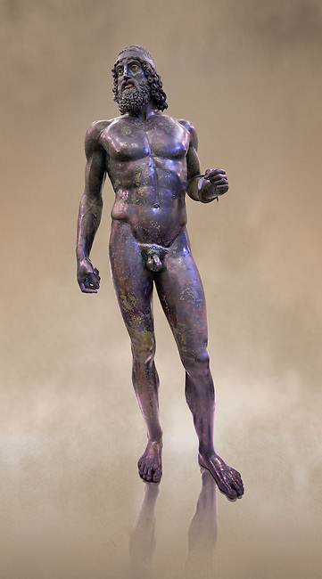 low full length view of the  Riace bronze Greek statue A cast about 460 BC. statue A was probably sculpted by Myron. The style of the Riace statues straddles the archaic period and heralds the start of the classical period. Both statues depict strong young naked warriors who stand calmly but exuding great power. Museo Nazionale della Magna Grecia,  Reggio Calabria, Italy.