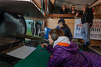 "Switzerland. Canton Ticino. Cureglia is a municipality in the district of Lugano. ""Tiratori del Gaggio"" society. Shooting range. Young shooters' course. The courses, whose organisation is delegated by the Federal Department of Defence, Civil Protection and Sport to the various local shooting societies, are open to young swiss people, boys and girls, from 15 to 20 years old. Girls and boys learn how to handle and fire with the assault rifle SG 550, also called Fass 90, used by the Swiss Army. Giulia is 15 years old. She shoots her Fass 90 loaded with bullets on targets distant 300 meters under the supervision of her instructor, Lory Ponzio (R). Acoustic foam used inside a pipe in to dampen and absorb the gun shot's sound. Giulia's parents are looking at their daughter shooting from above. The SG 550 is an assault rifle manufactured by Swiss Arms AG (formerly Schweizerische Industrie Gesellschaft) of Neuhausen, Switzerland. ""SG"" is an abbreviation for Sturmgewehr, or ""assault rifle"". The rifle is known as the Fass 90 or Stgw 90. An assault rifle is a selective-fire rifle that uses an intermediate cartridge and a detachable magazine. 16.02.2019 © 2019 Didier Ruef"