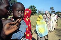 Sudan. South Sudan. Bahr El Ghazal. Mayen Abun. Dinka slave woman and her child bought back by Christian Solidarity International (CSI) from muslim arab traders. © 1999 Didier Ruef