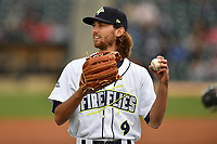 Center fielder Gene Cone (9) of the Columbia Fireflies warms up before a game against the Lakewood BlueClaws on Friday, May 5, 2017, at Spirit Communications Park in Columbia, South Carolina. Lakewood won, 12-2. (Tom Priddy/Four Seam Images)