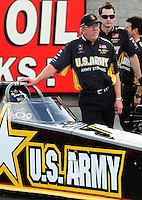 Oct. 31, 2008; Las Vegas, NV, USA: NHRA top fuel dragster driver Tony Schumacher sits in his car as crew chief Alan Johnson stands alongside during qualifying for the Las Vegas Nationals at The Strip in Las Vegas. Mandatory Credit: Mark J. Rebilas-