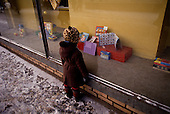 """Moscow, Russia<br /> Soviet Union<br /> December 12, 1991<br /> <br /> A young child looks at the toys in the window of the largest children's department store on Lubianka Square just adjacent to the head-quarters of the KGB.<br /> <br /> In December 1991, food shortages in central Russia had prompted food rationing in the Moscow area for the first time since World War II. Amid steady collapse, Soviet President Gorbachev and his government continued to oppose rapid market reforms like Yavlinsky's """"500 Days"""" program. To break Gorbachev's opposition, Yeltsin decided to disband the USSR in accordance with the Treaty of the Union of 1922 and thereby remove Gorbachev and the Soviet government from power. The step was also enthusiastically supported by the governments of Ukraine and Belarus, which were parties of the Treaty of 1922 along with Russia.<br /> <br /> On December 21, 1991, representatives of all member republics except Georgia signed the Alma-Ata Protocol, in which they confirmed the dissolution of the Union. That same day, all former-Soviet republics agreed to join the CIS, with the exception of the three Baltic States."""