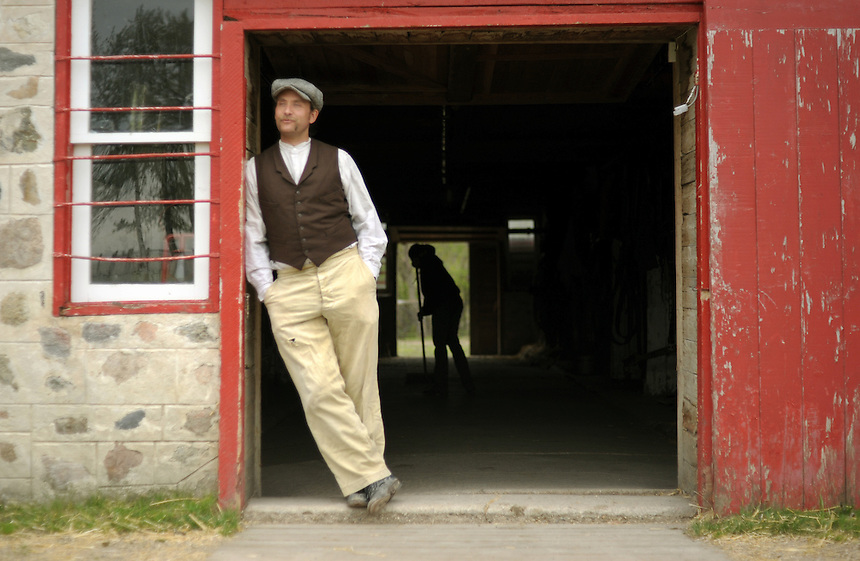 Sheldon Matsalla stands in the doorway of the 105-year-old barn at the Motherwell Homestead near Abernathy, Saskatchewan. MARK TAYLOR FOR THE GLOBE AND MAIL.