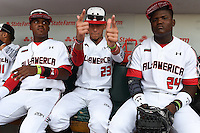 Nicholas Shumpert (22), Anthony Molina (23) and Starling Heredia (24) sit in the dugout before the Under Armour All-American Game on August 16, 2014 at Wrigley Field in Chicago, Illinois.  (Mike Janes/Four Seam Images)