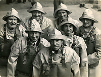 BNPS.co.uk (01202 558833)<br /> Pic: FoxPhotosRNLI<br /> <br /> Recipients of gallantry medals, 18 Oct 1946.<br /> <br /> Splash in the Attic...<br /> <br /> A 'lost' cache of 13,000 photographs charting the history of the RNLI has been found in the attic of the charity's headquarters.<br /> <br /> Many of the black and white photos date back to the 1920s and '30s long before the terms 'health and safety' and 'risk assessment' were thought of.<br /> <br /> One image depicts a brave lifeboatman dressed in a suit and cloth cap just as the lifeboat he is on launches down a ramp into a choppy sea.<br /> <br /> Another shows the crew of another open lifeboat getting swamped by waves with only their souwesters and lifejackets to protect them.<br /> <br /> The photos have been unearthed in storage space at the RNLI HQ in Poole, Dorset, and they are now being digitised.