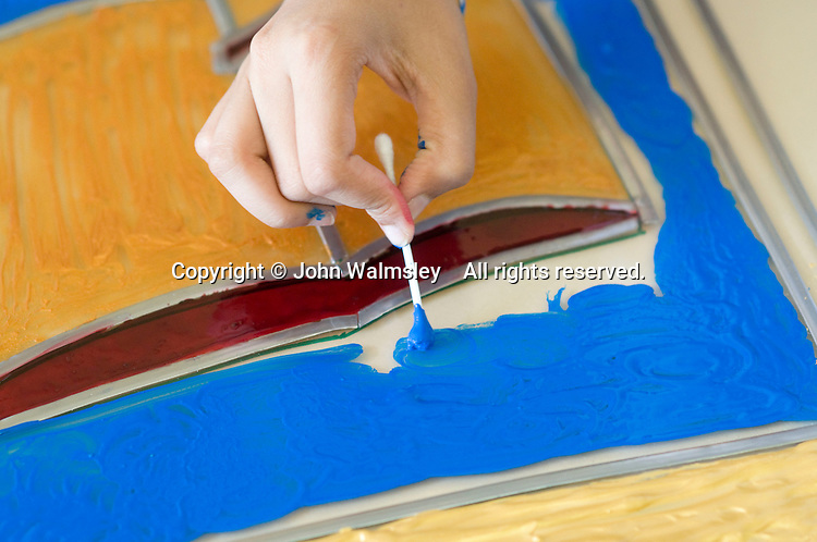 Painting a stained glass window,  State Secondary Roman Catholic school.