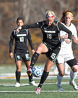 Wilmington University defender Morgan Fraczkowski (15) attempts to control the ball as College of St Rose forward Laura Taylor (21) defends.. In 2012 NCAA Division II Women's Soccer Championship Tournament First Round, College of St Rose (white) defeated Wilmington University (black), 3-0, on Ronald J. Abdow Field at American International College on November 9, 2012.