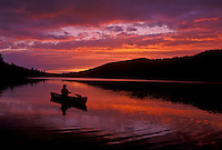 canoeing, canoe, sunrise, sunset, Vermont, VT, Silhouette of a woman paddling a canoe on Kettle Pond at sunset in Groton State Forest.