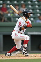 Second baseman Kervin Suarez (36) of the Greenville Drive bats in a game against the Augusta GreenJackets on Thursday, May 17, 2018, at Fluor Field at the West End in Greenville, South Carolina. Augusta won, 2-1. (Tom Priddy/Four Seam Images)