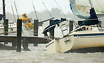 After throwing an additional rope on a post, Paul  Pflueger  attempts tpo secure his boat tied up under the Apalachicola bridge as Tropical Storm Claudette pounds the Florida panhandle coast in Apalachicola, Florida August 16, 2009.