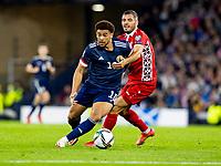 4th September 2021; Hampden Park, Glasgow, Scotland: FIFA World Cup 2022 qualification football, Scotland versus Moldova: Che Adams of Scotland gets past Vadim Bolohan of Moldova