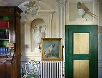 The reading room on the ground floor features a mural of architectural details alongside naively painted pheasants and monkeys executed in the 1990s
