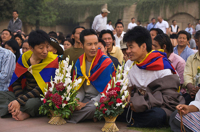 Tibetan Buddhists attend a PRAYER FOR WORLD PEACE sponsored by the14th Dalai Lama of Tibet at the RAJ GHAT (Ghandi's eternal flame) in April of 2008 -  NEW DELHI, INDIA