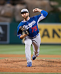 Los Angeles Dodger pitcher, Paco Rodriguez delivers a pitch against the Los Angeles Angels.