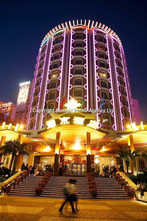 The Lisboa Hotel and casino at night in Macau. As restrictions on betting licences have become open to tender international Casino operators such as Wynn, Sands and MGM are making huge investments into Macau which is becoming the Vegas of the East and is driven by the massive Chinese gambling market on the former Portuguese colony's doorstep..