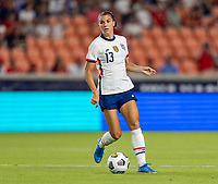 HOUSTON, TX - JUNE 10: Alex Morgan #13 of the USWNT passes the ball during a game between Portugal and USWNT at BBVA Stadium on June 10, 2021 in Houston, Texas.