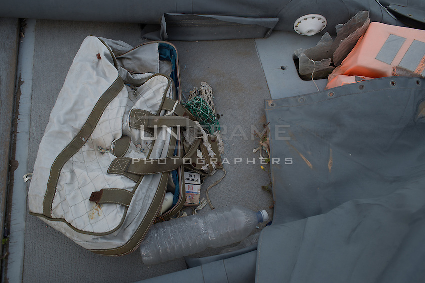 Belongings on wreckages of fishing boats used by human traffickers in the Sicilian port of Pozzallo. Every week new wreckages are added here to the pile by the port authority, following each rescue mission by the Italian coast guard in the strait of Sicily, Mediterranean sea. The Mare Nostrum operation has been replaced by Frontex operation Triton on Nov. 2014 with consistent critics, highlighted by the recent shipwreck of Apr. 19, 2015 in which more than 850 refugees have drowned. Pozzallo, Italy. Apr. 04, 2015