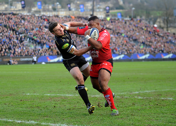 Steffon Armitage of RC Toulon brushes George Ford of Bath Rugby aside to score a try during the European Rugby Champions Cup match between Bath Rugby and RC Toulon - 23/01/2016 - The Recreation Ground, Bath Mandatory Credit: Rob Munro/Stewart Communications