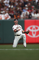 SAN FRANCISCO, CA - AUGUST 7:  Aaron Rowand of the San Francisco Giants makes a play in left field against the Philadelphia Phillies during the game at AT&T Park on August 7, 2011 in San Francisco, California. Photo by Brad Mangin