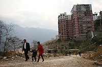 CHINA. Chongqing Province.  A family in the town of Wushan, which lies on the banks of the Yangtze and at the entrance to the 3 Gorges. As tourism booms, towns are being developed and modernized resulting in old areas being razed.  The flooding of the three Gorges, by damming the Yangtze near the town of YiChang, has remained a controversial subject due to the negative environmental consequences and the displacement of millions of people in the flood plain. The Yangtze River however is reported to be at its lowest level in 150 years as a result of a country-wide drought. It is China's longest river and the third longest in the world. Originating in Tibet, the river flows for 3,964 miles (6,380km) through central China into the East China Sea at Shanghai.  2008.