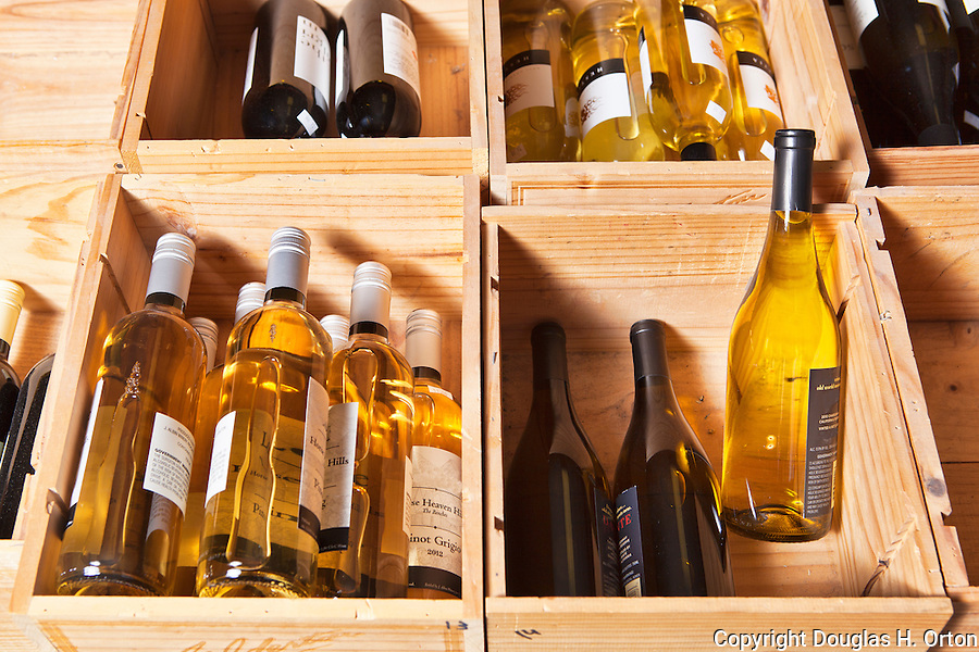 Open Wooden Cases of Wine.  White wine and red wine.  No brand names visible.