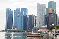Financial District Skyline, Water Taxi in Foreground, Singapore.