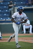 Lawrence Butler (4) of the Stockton Ports runs to first base during a game against the Rancho Cucamonga Quakes at LoanMart Field on May 26, 2021 in Rancho Cucamonga, California. (Larry Goren/Four Seam Images)