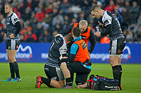 Rhodri Jones of the Ospreys is examined by team medical staff during the Guinness Pro14 match between the Ospreys and Cardiff Blues at the Liberty Stadium, Swansea, Wales, UK. Saturday 05 January 2018