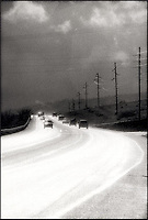 Automobiles on stormy road<br />