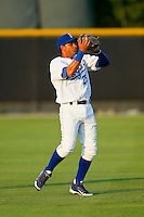 Burlington Royals shortstop Ramon Torres (25) makes a catch in shallow left field during the Appalachian League game against the Pulaski Mariners at Burlington Athletic Park on June20 2013 in Burlington, North Carolina.  The Royals defeated the Mariners 2-1 in 13 innings.  (Brian Westerholt/Four Seam Images)
