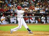 Jul. 20, 2010; Phoenix, AZ, USA; Arizona Diamondbacks outfielder Justin Upton hits a solo home run in the third inning against the New York Mets at Chase Field. Mandatory Credit: Mark J. Rebilas-