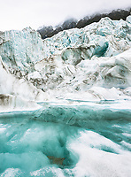 Glacial lake and ice formations on Fox Glacier, Westland Tai Poutini National Park, UNESCO World Heritage Area, West Coast, New Zealand, NZ