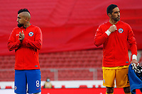 13th November 2020; National Stadium of Santiago, Santiago, Chile; World Cup 2020 Football qualification, Chile versus Peru;  Arturo Vidal and Claudio Bravo of Chile during their anthem