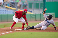 Clearwater Threshers third baseman Kendall Simmons (46) tags Andres Chaparro (24) out on a stolen base attempt during a game against the Tampa Tarpons on June 10, 2021 at BayCare Ballpark in Clearwater, Florida.  (Mike Janes/Four Seam Images)