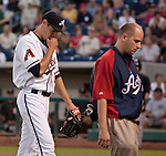 Reno Aces starting pitcher Joe Martinez leves the game with a trainer after being hit in the wrist by a line drive agianst the Fresno Grizzlies during their game on Friday night August 10, 2012 at Aces Ballpark in Reno NV.