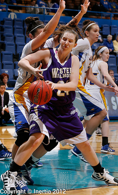 SIOUX FALLS, SD - MARCH 5:  Sadie Webb #24 from Western Illinois University drives into Brianna Eldridge #22 from UMKC during the second half of their semifinal game Monday afternoon at the 2012 Summit League Tournament at the Sioux Falls Arena.  (Photo by Dick Carlson/Inertia)