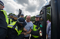 Anti fascists from Stand Up To Racism, Unite Against Fascism and the Anti Fascist Network protest against the far right 'Free Tommy - Welcome Trump' demonstration in Whitehall. Hundreds of Police kept the two sides apart though there were scuffles. 14-7-18 A far right Tommy Robinson is briefly detained by the police for attacking anti fascists with a weapon. He was then released for reasons that were unclear.