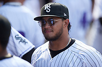 Winston-Salem Dash catcher Kleyder Sanchez (18) listens to Eloy Jimenez (reflected in his sunglasses) talk prior to the game against the Hickory Crawdads at Truist Stadium on July 10, 2021 in Winston-Salem, North Carolina. (Brian Westerholt/Four Seam Images)