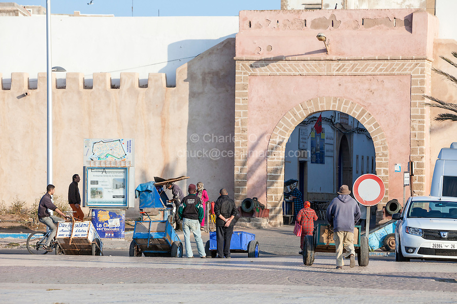 Essaouira, Morocco.  Bab Marrakesh.  Porters with their Carts wait outside the Gate for Customers; Motorized Vehicles not allowed inside the Medina.