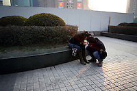 CHINA. Shanghai. A young couple in Pudong. Shanghai is a sprawling metropolis or 15 million people situated in south-east China. It is regarded as the country's showcase in development and modernity in modern China. This rapid development and modernization, never seen before on such a scale has however spawned countless environmental and social problems. 2008.