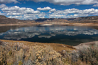 Clouds in the sky and their reflections in the waters of Blue Mesa Reservoir near Gunnison on Colorado's western slope.