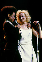 """Montreal (Qc) CANADA - August 8,1986 File Photo -<br /> <br /> Eartha Kitt (L) concert with Marjo (R) in Montreal.<br /> <br /> Eartha Mae Kitt (born on January 17, 1927)[1] is an American actress, singer, and cabaret star. She is known for her role as Catwoman in the 1960s TV series Batman, and for her 1953 Christmas song """"Santa Baby."""" Orson Welles once called her """"the most exciting woman in the world."""".<br /> <br /> Marjolaine Morin (born 2 August 1953 in Montreal, Quebec), professionally known as Marjo, is a francophone Canadian singer-songwriter. After singing in two musicals of Fran??ois Guy, Marjo joined the band Corbeau in 1979, two years after the group was started by Pierre Harel.<br /> <br /> Her solo career began shortly after Corbeau disbanded with the theme song for the film La Femme de l'h??tel which earned a Genie Award for Best Original Song in 1985. In 1986, her debut album Celle qui va sold more than 250 000 copies.<br /> <br /> -Photo (c)  Images Distribution"""