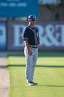 Asheville Tourists manager Warren Schaeffer (13) coaches third base during the game against the Kannapolis Intimidators at Intimidators Stadium on June 28, 2015 in Kannapolis, North Carolina.  The Tourists defeated the Intimidators 6-4.  (Brian Westerholt/Four Seam Images)