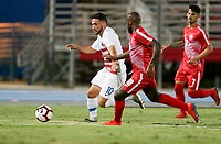 GEORGETOWN, GRAND CAYMAN, CAYMAN ISLANDS - NOVEMBER 19: Cristian Roldan of the United States moves with the ball past Jose Almelo #18 of Cuba during a game between Cuba and USMNT at Truman Bodden Sports Complex on November 19, 2019 in Georgetown, Grand Cayman.