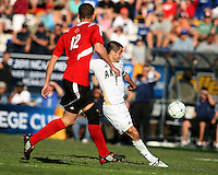Michael Nanchoff #9 of the University of Akron winds up for a shot past Chase Rodgers #12 of the University of Louisville during the 2010 College Cup final at Harder Stadium, on December 12 2010, in Santa Barbara, California.Akron champions, 1-0.