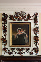 Exquisite Grinling Gibbons carvings frame an early 19th century portraits of a woman and child