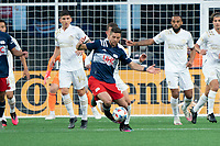 FOXBOROUGH, MA - MAY 1: Matt Polster #8 of New England Revolution passes the ball to the midfield near the Atlanta United goal during a game between Atlanta United FC and New England Revolution at Gillette Stadium on May 1, 2021 in Foxborough, Massachusetts.