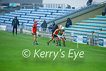 Lixnaw's Aodhan Shanahan been tackled by Jordan Goggin of Ballyheigue as his team mate David O'Mahony calls for a side line ball in Round 2 of the County Senior Hurling championship,