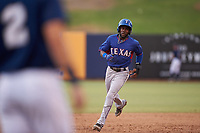 AZL Rangers Rafy Barete (21) rounds the bases after a home run by Keyber Rodriguez (not pictured) during an Arizona League game against the AZL Brewers Blue on July 11, 2019 at American Family Fields of Phoenix in Phoenix, Arizona. The AZL Rangers defeated the AZL Brewers Blue 5-2. (Zachary Lucy/Four Seam Images)